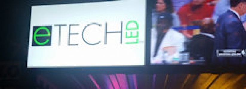 eTech LED logo on TV at the party